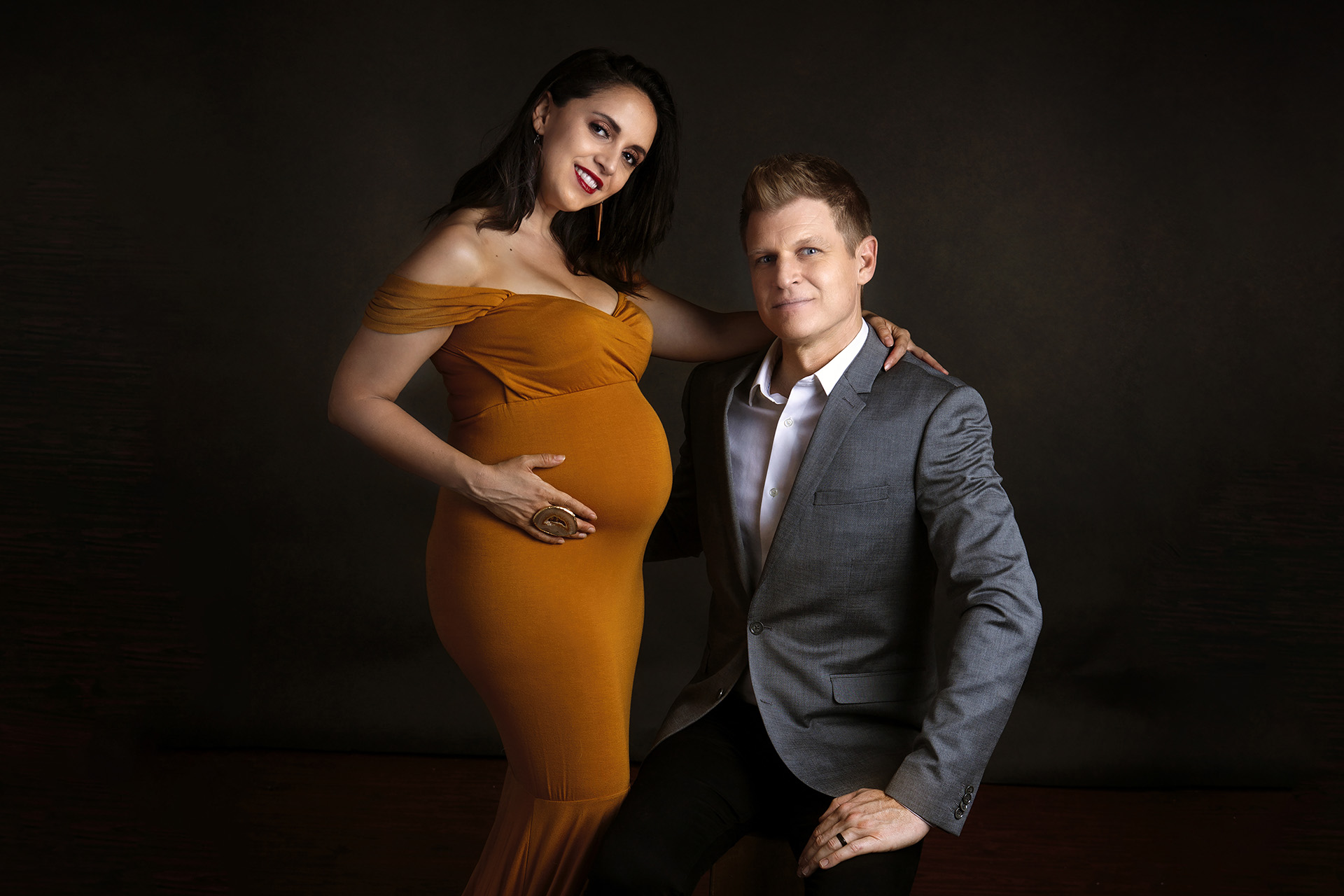 Los Angeles maternity portrait of a woman in a gold dress and her partner by Birth and Beauty