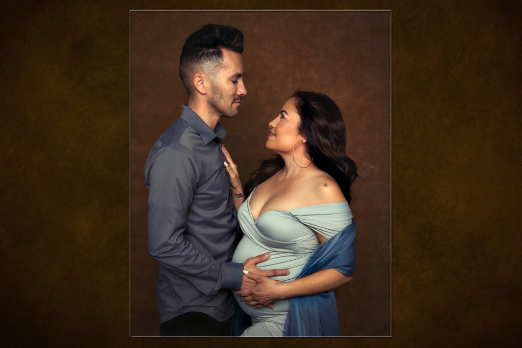 Color Maternity images of a woman and her partner embracing
