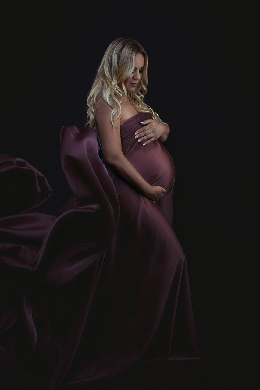 Los Angeles celebrity maternity photographer Leona Darnell captures this mom to be in a colorful mauve chiffon draped around her