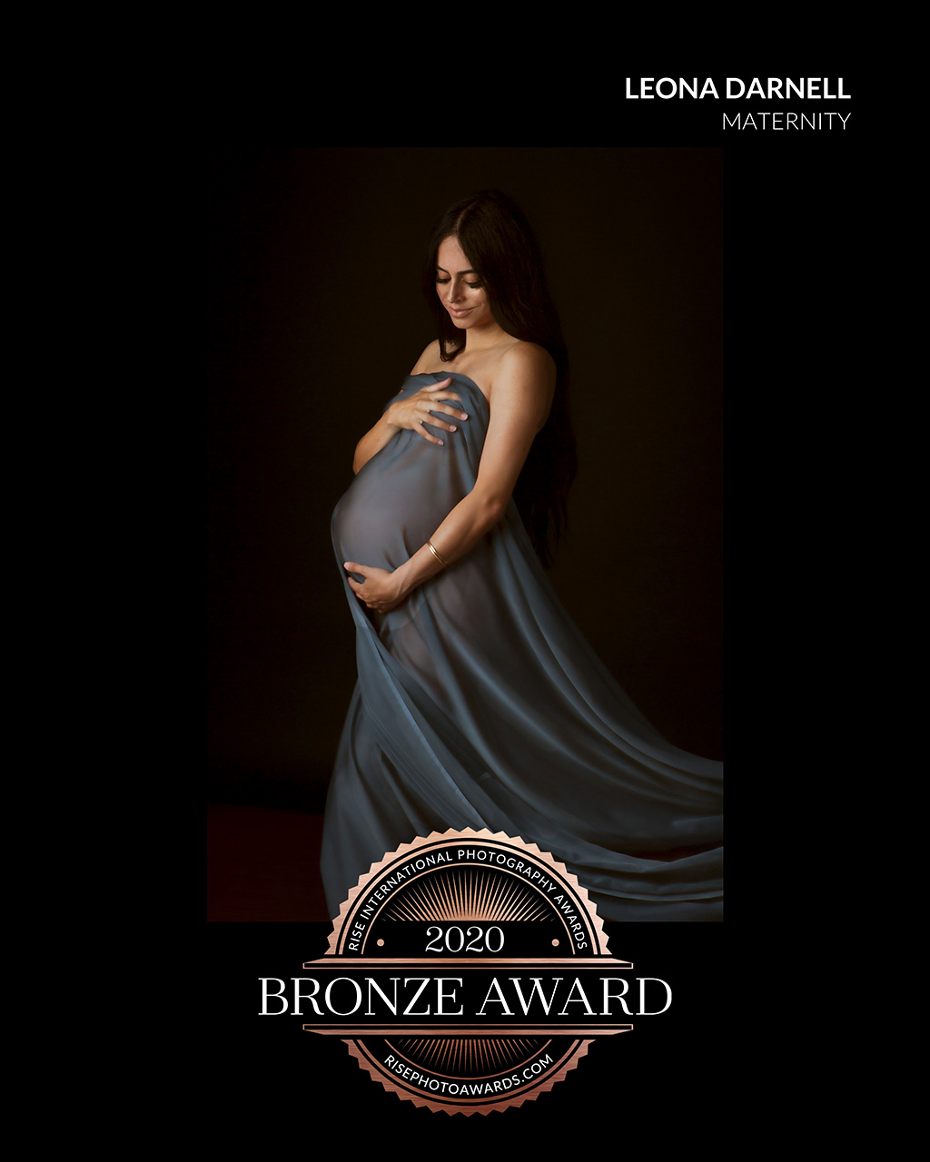 winning los angeles color maternity portrait  of a woman wearing blue material