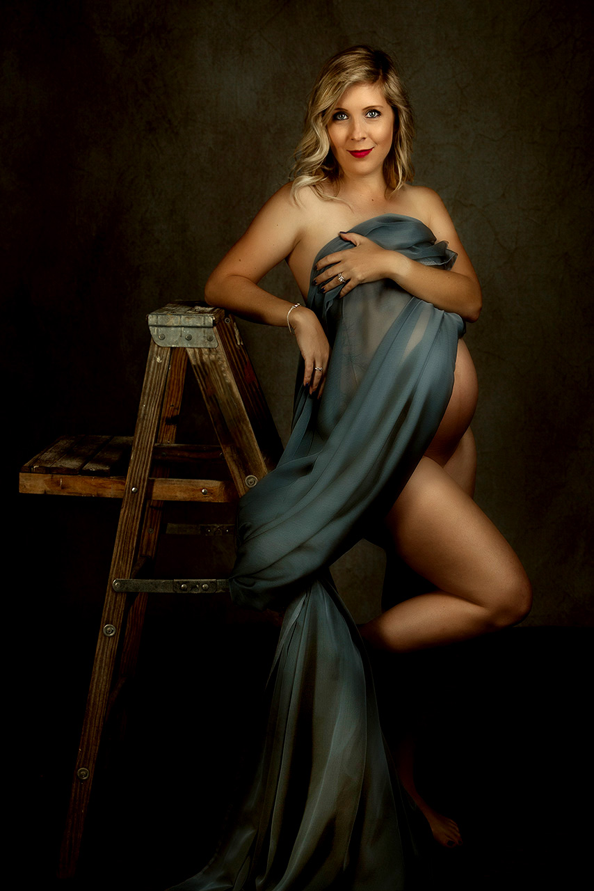 Santa monica maternity portrait of a woman under a blue drape by Birth and Beauty