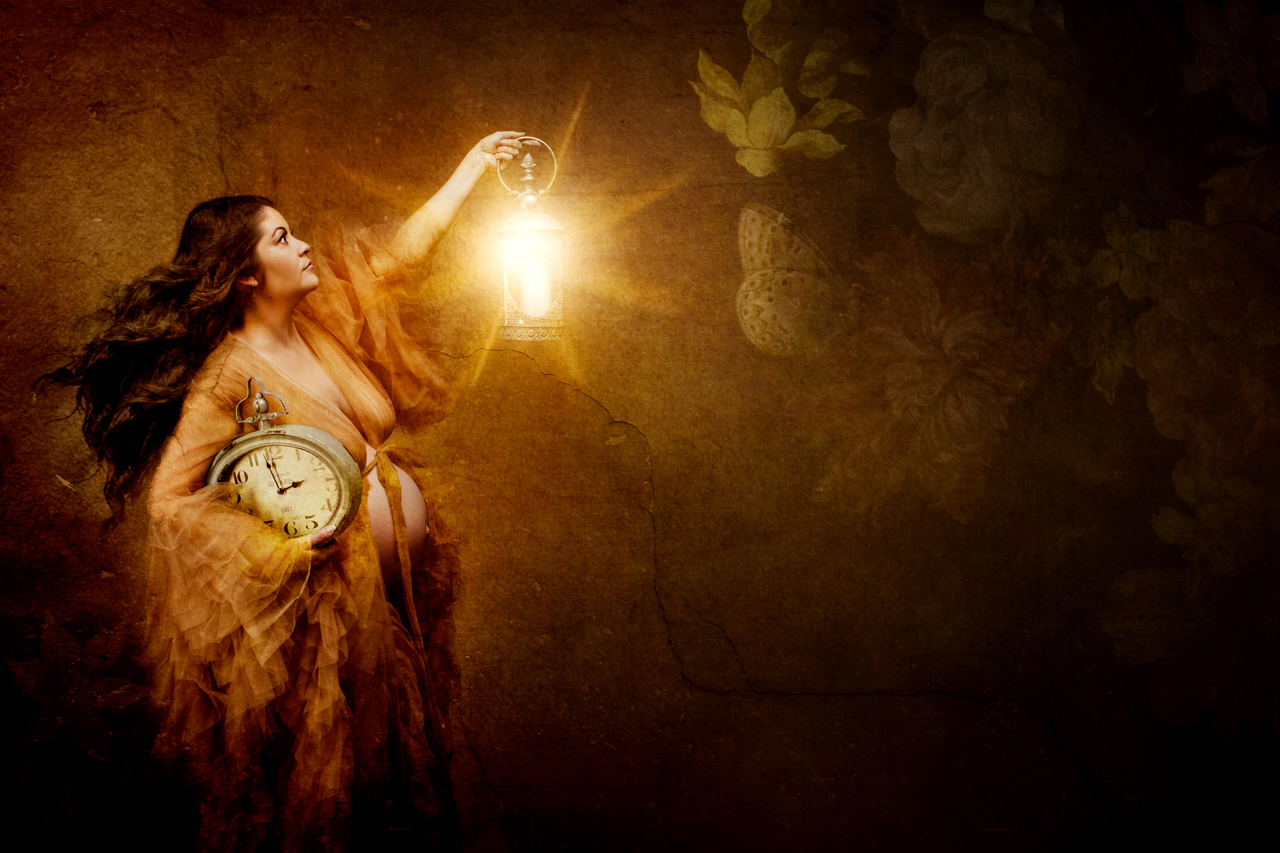 fine art maternity portrait of a woman holding a clock and lantern