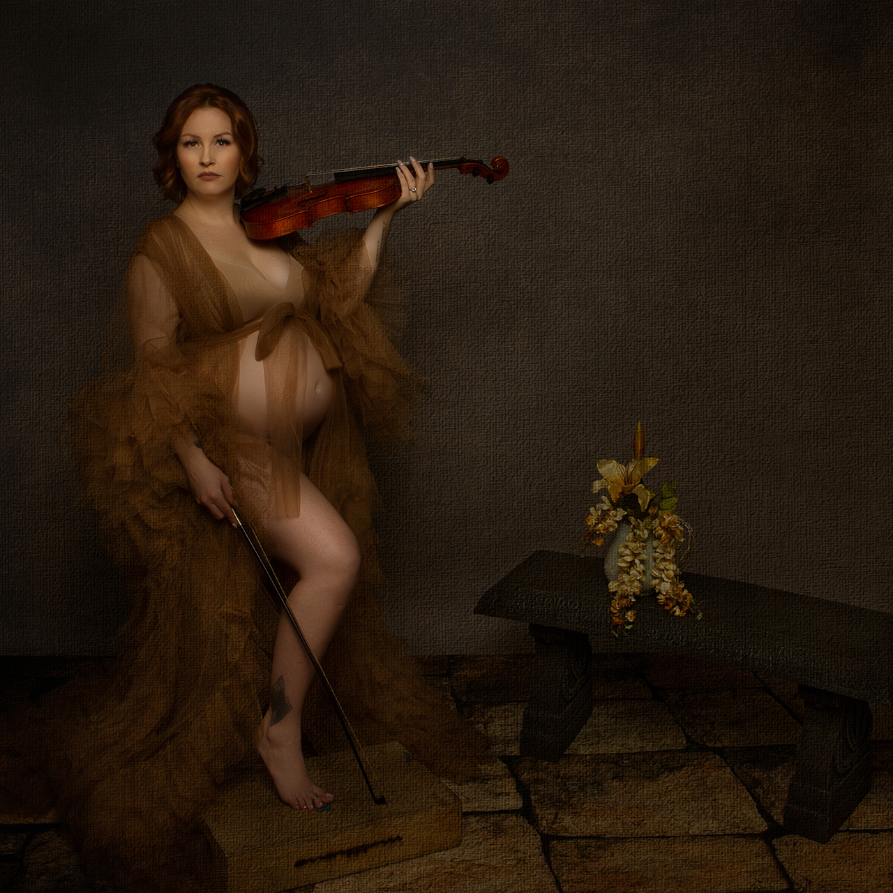 Los Angeles Maternity photographer, Leona Darnell, shows an image of a pregnant mother holding a violin.