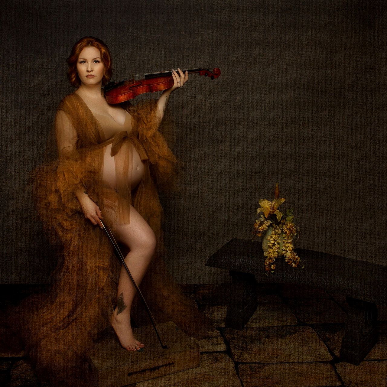 maternity-photography portrait of a women in a robe holding a violin by Birth and Beauty