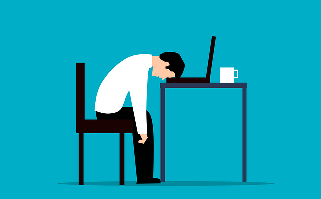 cartoon picture of a tired person sitting at a desk